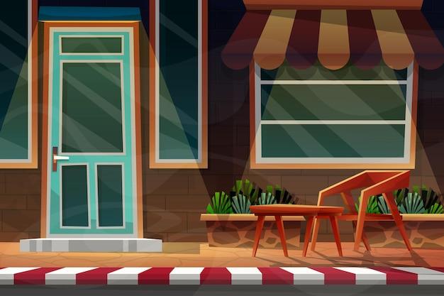 Nachtszenenfront außen des hauses mit stuhl und tisch unter sonnenschirmfassade.