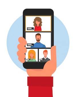 Nahaufnahme einer hand mit einem handy von hinten, das durch videokonferenz kommuniziert. virtuelles meeting. videokonferenz. video-chat. videoanruf.