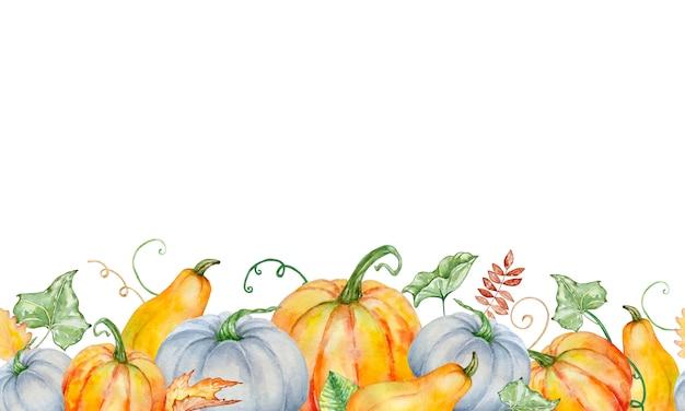 Nahtlose kompositionsgrenze des aquarellherbstes mit leuchtend orangefarbenen und blauen kürbissen