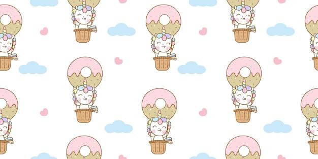 Nahtlose muster-einhorn-karikatur im süßen donutballon auf himmel kawaii tier