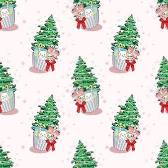Nahtlose muster katze und weihnachtsbaum in cup cake cartoon