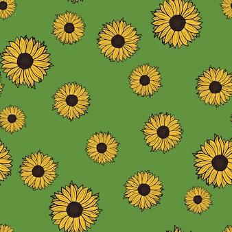 Nahtlose muster sonnenblumen auf grünem hintergrund. schöne textur mit gelben sonnenblumen und blättern.