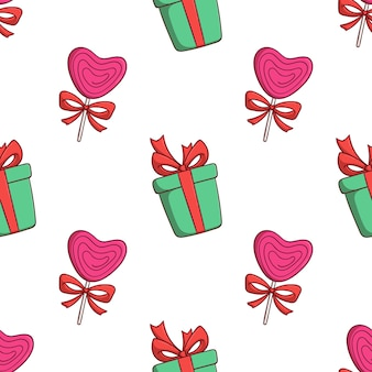 Nahtlose muster weihnachten geschenkbox und liebe süßigkeiten