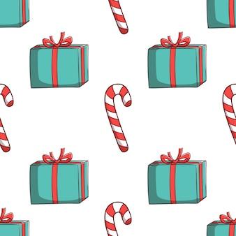 Nahtlose muster weihnachtsgeschenkbox und süßigkeiten
