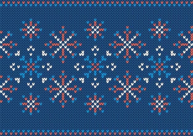 Nahtlose textur stricken. weihnachtsmuster mit schneeflocke. blauer strickpulloverdruck. weihnachtshintergrund