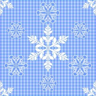 Nahtloser blauer hintergrund in einem käfig mit weißen schneeflocken