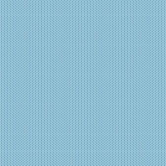 Nahtloser blauer hintergrund mit realistischer gestrickter beschaffenheit.