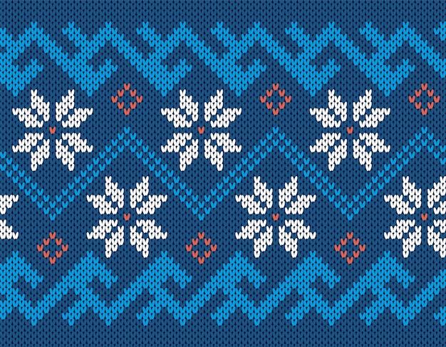Nahtloser druck stricken. weihnachtsmuster. blaue strickpullover textur. holiday fair isle ornament.