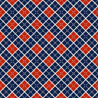 Nahtloser hintergrund mit blauen und roten rauten.
