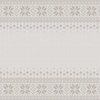Nahtloser hintergrund mit copyspace gestrickt. weißes und graues pullovermuster für weihnachts- oder winterdesign. traditionelle skandinavische verzierung