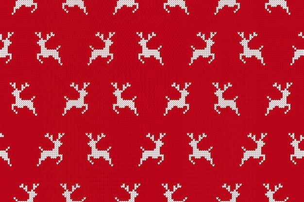 Nahtloser hintergrund mit rentieren stricken. weihnachtsrotes muster.