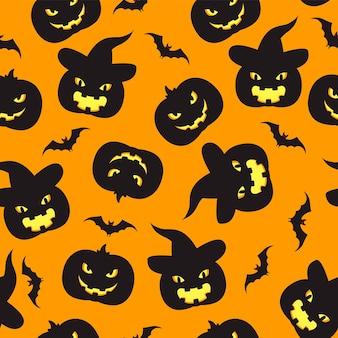 nahtloser muster-halloween-hintergrund mit kürbissen und fledermäusen