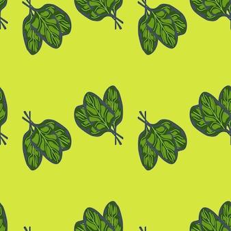 Nahtloser musterbündelspinatsalat auf hellgrünem hintergrund. einfache verzierung mit salat.