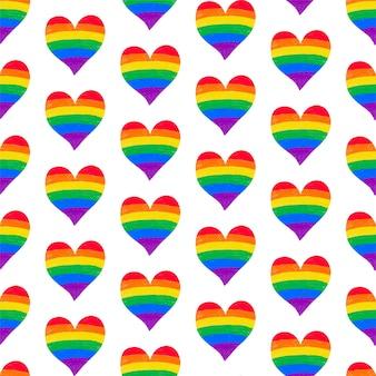 Nahtloser musterhintergrund mit regenbogen-lgbtq-gay-pride-flagge färbt herzform, kreidestift strukturiert. vektorhintergrund für den monat der lgbt-geschichte, den pride-monat