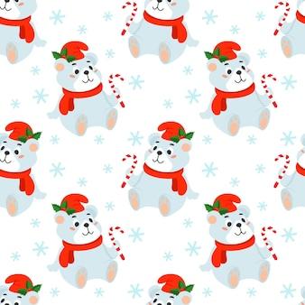 Nahtloser weihnachtshintergrund mit einem eisbären in einem roten hut und einer zuckerstange in seiner pfote.