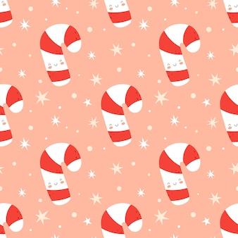 Nahtloser weihnachtshintergrund mit netter zuckerstange. vektor-illustration im flachen cartoon-stil auf einem rosa hintergrund. ideal für stoff und geschenkpapier.