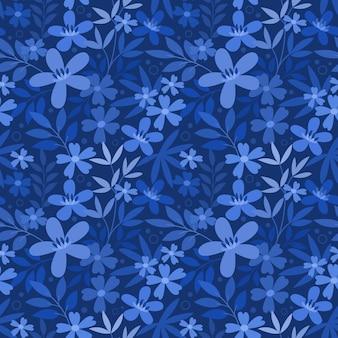 Nahtloses blumenmuster auf blauem monochromem hintergrund.