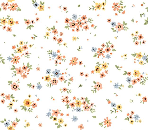 Nahtloses blumenmuster für design kleine bunte blumen weißer hintergrund vinta blumenmuster