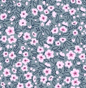 Nahtloses blumenmuster für design kleine rosa blumen grauer hintergrund vorlage für modedruck