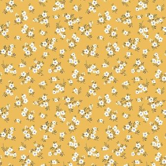 Nahtloses blumenmuster für design kleine weiße blumen gelber hintergrund modernes blumenmuster