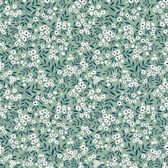 Nahtloses blumenmuster für design kleine weiße blumen graugrüner hintergrund modedruck