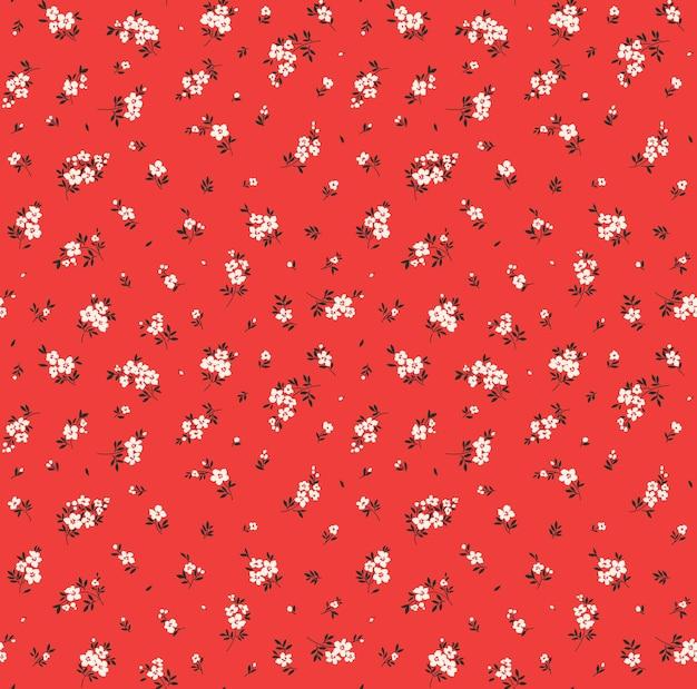 Nahtloses blumenmuster für design kleine weiße blumen roter hintergrund modernes blumenmuster