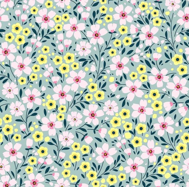 Nahtloses blumenmuster für. kleine rosa blüten. grau-blauer hintergrund. modernes blumenmuster.
