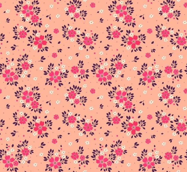 Nahtloses blumenmuster für. kleine rosa blüten. korallenhintergrund. vorlage für modedruck