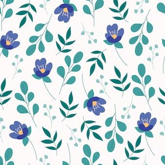 Nahtloses blumenmuster mit grünen blättern und blauen blüten