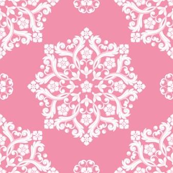Nahtloses damastmuster auf rosa farbe