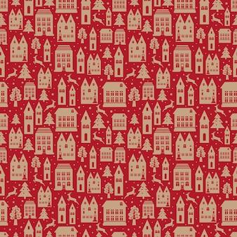 Nahtloses farbmuster der alten stadt mit alten gebäuden für tapete oder hintergrunddesign auf rot. weihnachts- und neujahrswinterhintergrund.
