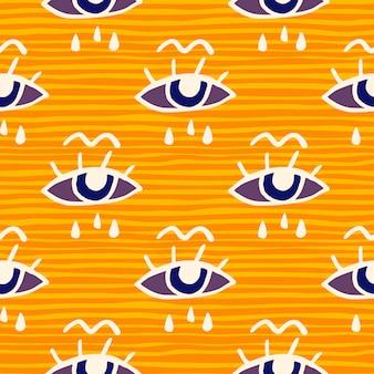 Nahtloses gekritzelmuster von auge und tränen. gelber und orange gestreifter hintergrund. weiß konturierte elemente.