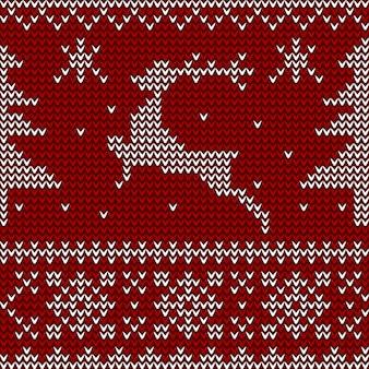 Nahtloses gestricktes muster mit rotwild, weihnachtsbäumen und schneeflocken.