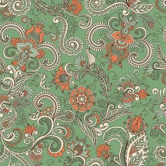 Nahtloses grünes und orangefarbenes muster von spiralen, wirbeln, kritzeleien