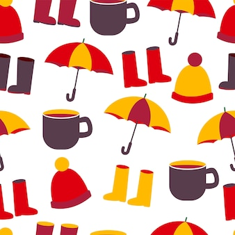 Nahtloses herbst-herbst-muster mit hut-stiefel-tasse und regenschirm