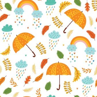 Nahtloses herbstmuster mit regenschirmen, wolken mit regen und regenbogen.