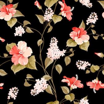 Nahtloses muster der flieder- und hibiskusblüte