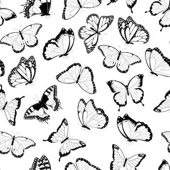 Nahtloses muster der fliegenden schmetterlinge der schwarzweiss. auf weißem hintergrund isoliert. .