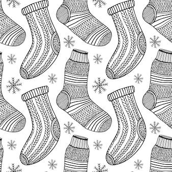 Nahtloses muster der gestrickten socken im handgezeichneten stil