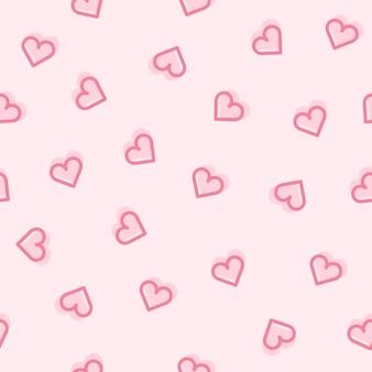 Nahtloses muster der herzen auf einem rosa hintergrund