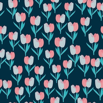 Nahtloses muster der kleinen tulpensilhoutten. dunkelblauer hintergrund mit rosa und blauen blumen.