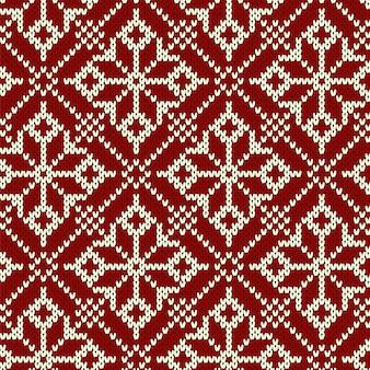 Nahtloses muster der weihnachtsstrickerei mit geometrischen schneeflocken.