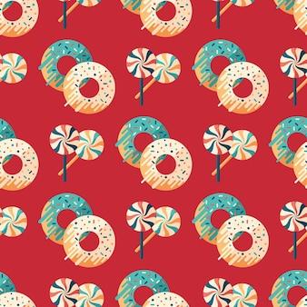 Nahtloses muster der weihnachtssüßigkeit und -schaumgummiringe flaches.