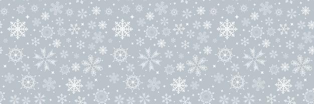 Nahtloses muster des abstrakten winterdesigns mit schneeflocken für weihnachten.