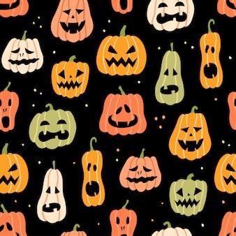 Nahtloses muster des halloween-kürbises. hand gezeichnete illustration auf schwarzem hintergrund