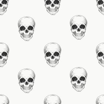 Nahtloses muster des menschlichen schädels. hand gezeichnete skelettillustration.