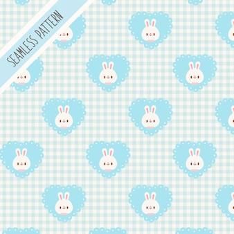 Nahtloses muster des niedlichen kaninchens und des blauen herzens. handgezeichneter hase