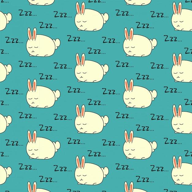 Nahtloses muster des schlafenden kaninchens auf grün