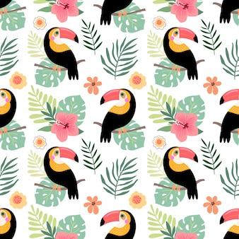 Nahtloses muster des sommers mit tukan und blumen