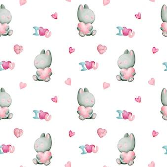 Nahtloses muster des valentinstagaquarells mit kaninchen und herzen